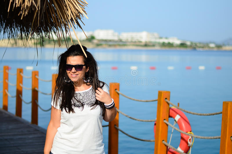 Young smiling brunette. Enjoying his summer vacation in Bodrum,Turkey stock photos