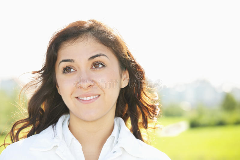 Download Young Smiling Brunette Looking Up Stock Image - Image: 16117285