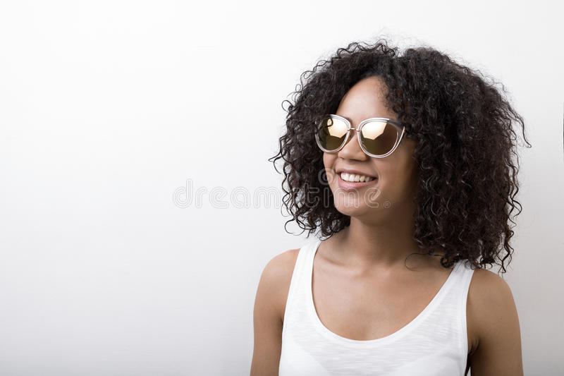 Young smiling brunette wearing sunglasses royalty free stock photo