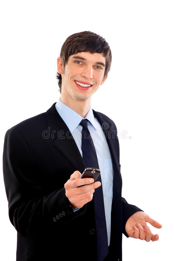 Young smiling business man using cell phone. Portrait of a young smiling business man using cell phone royalty free stock photography