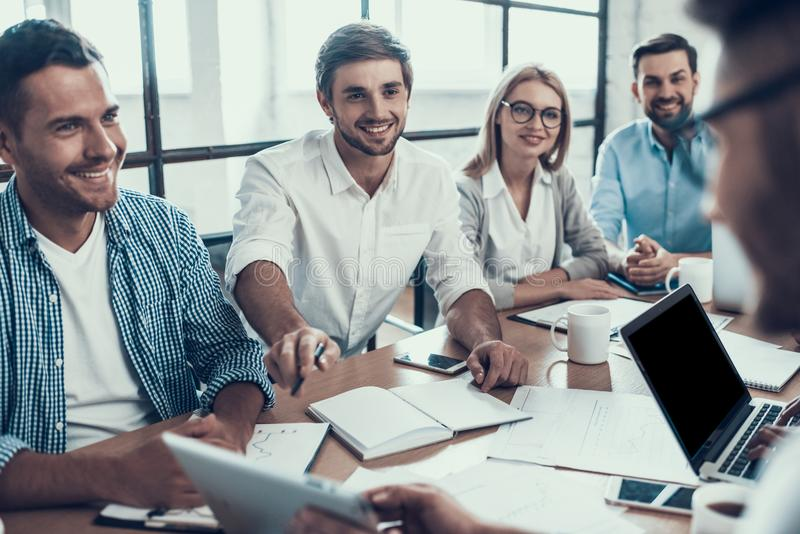 Young Smiling Business People on Meeting in Office royalty free stock photography