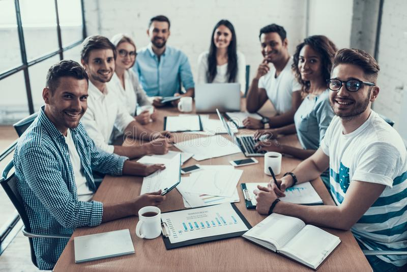 Young Smiling Business People on Meeting in Office stock images