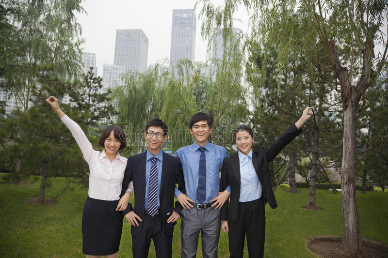 Young Smiling Business People In The Park, Portrait In A Row Royalty Free Stock Photo