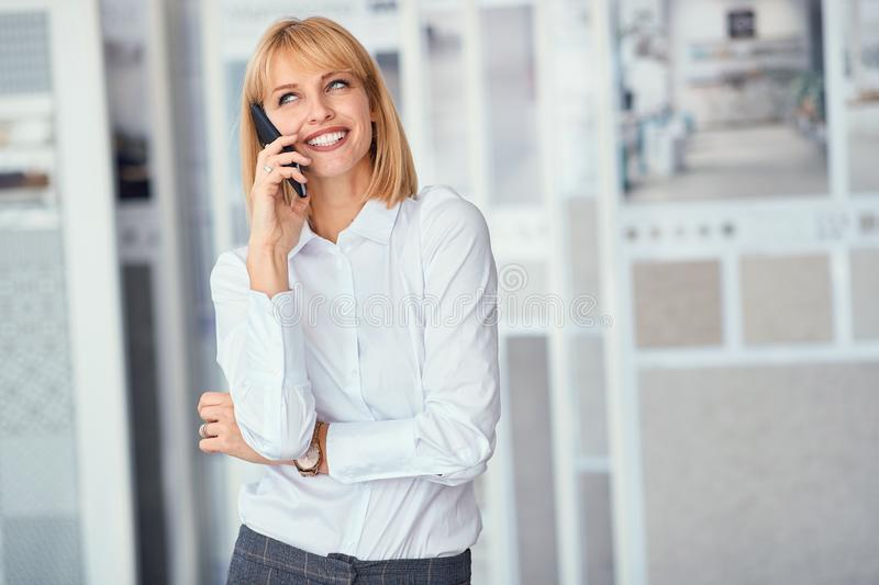 Young business woman working and communicating at the office royalty free stock photos