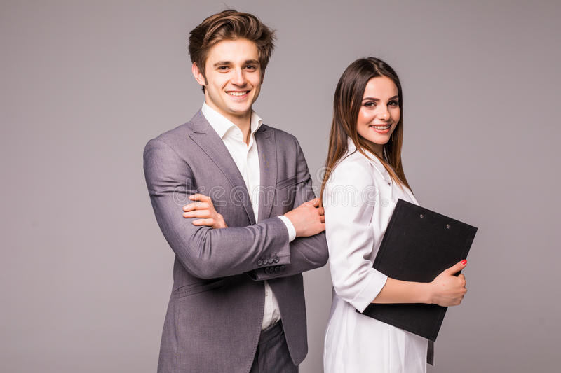 Young smiling business woman and business man isolated on gray background royalty free stock images