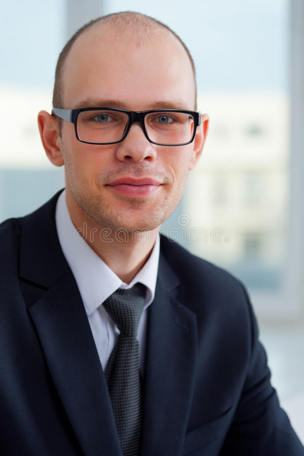 Young smiling businessman with glasses royalty free stock photo