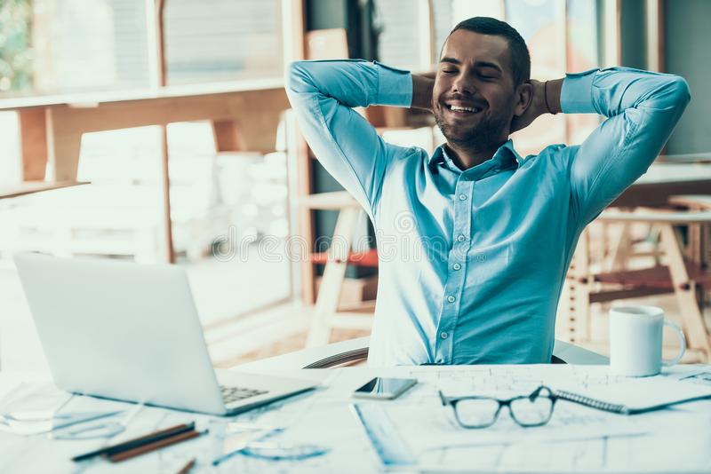 Young Smiling Businessman Resting in Office stock images