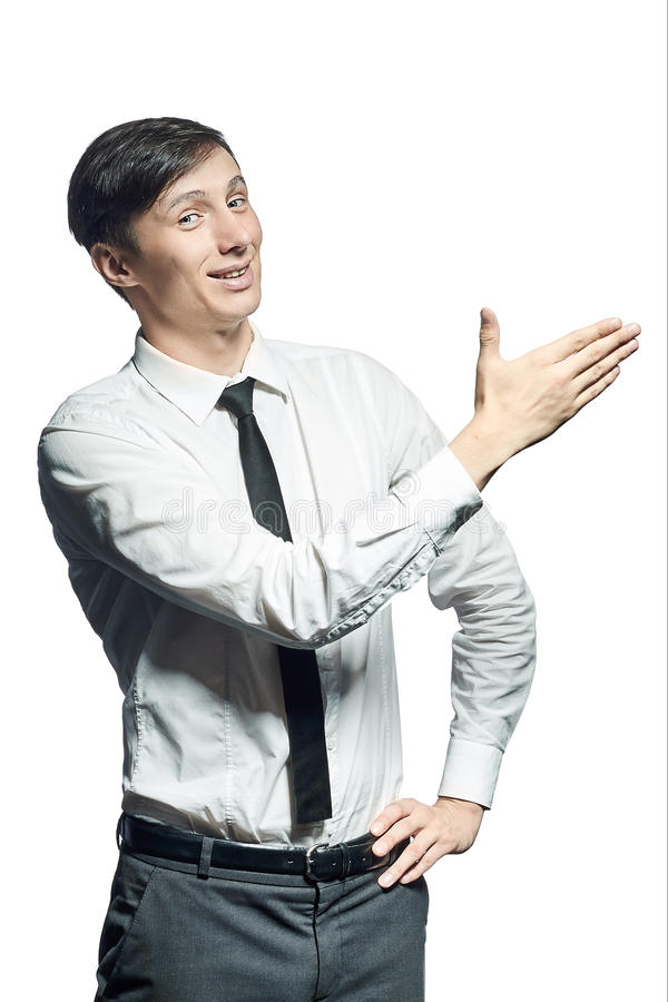 Young smiling businessman shows something stock photos