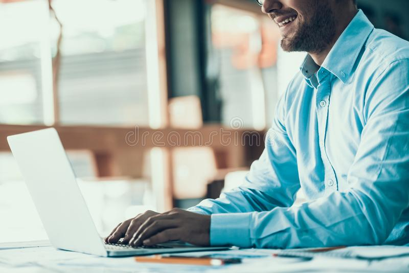 Young Smiling Businessman Working in Office stock photography