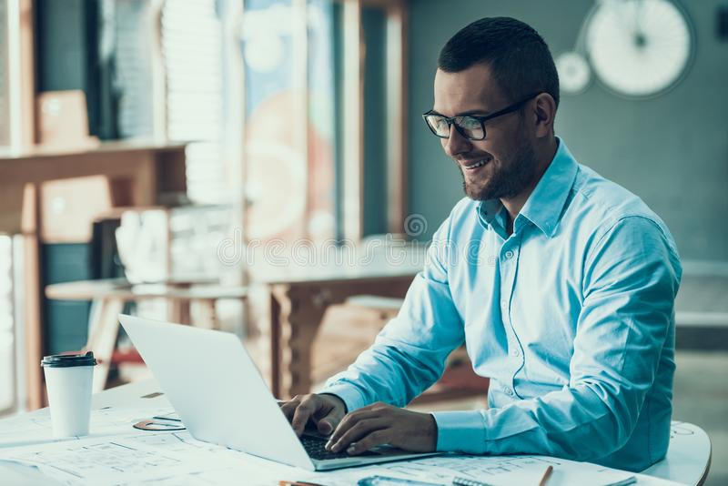 Young Smiling Businessman Working in Office stock image
