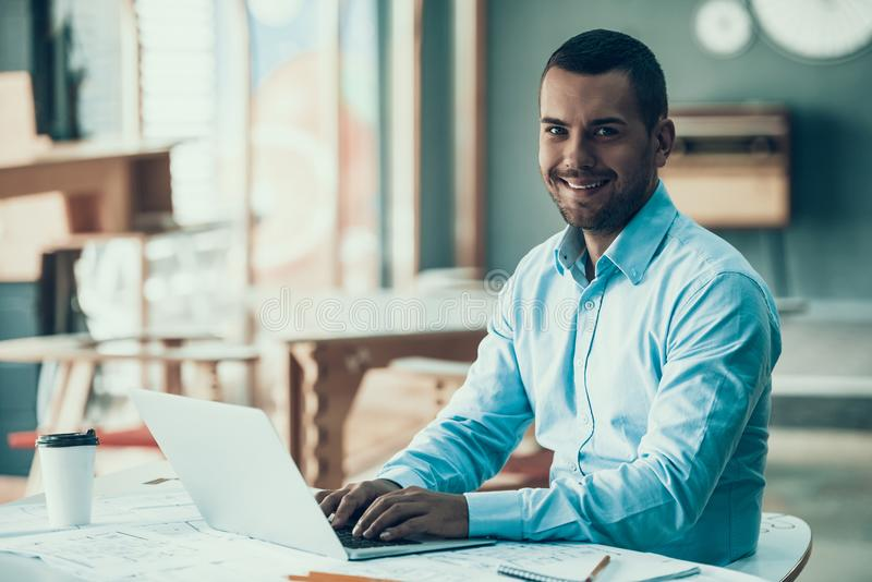 Young Smiling Businessman Working in Office stock photo
