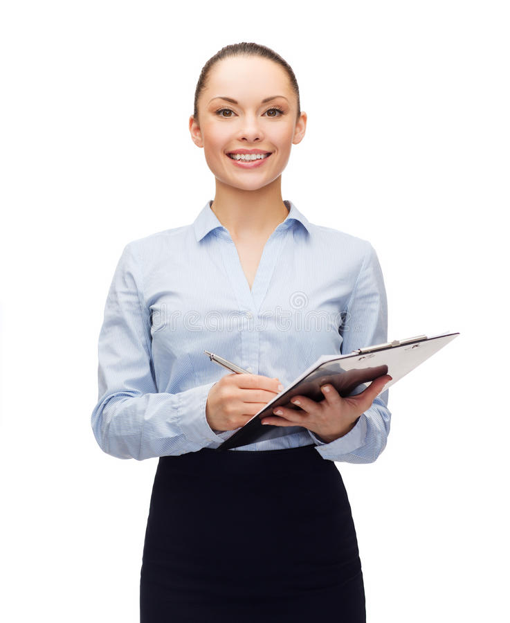 Young smiling businesswoman with clipboard and pen royalty free stock photos