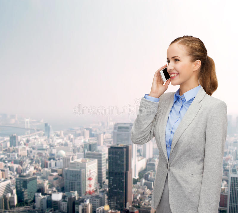 Download Young Smiling Businesswoman With Smartphone Stock Photo - Image: 40042758