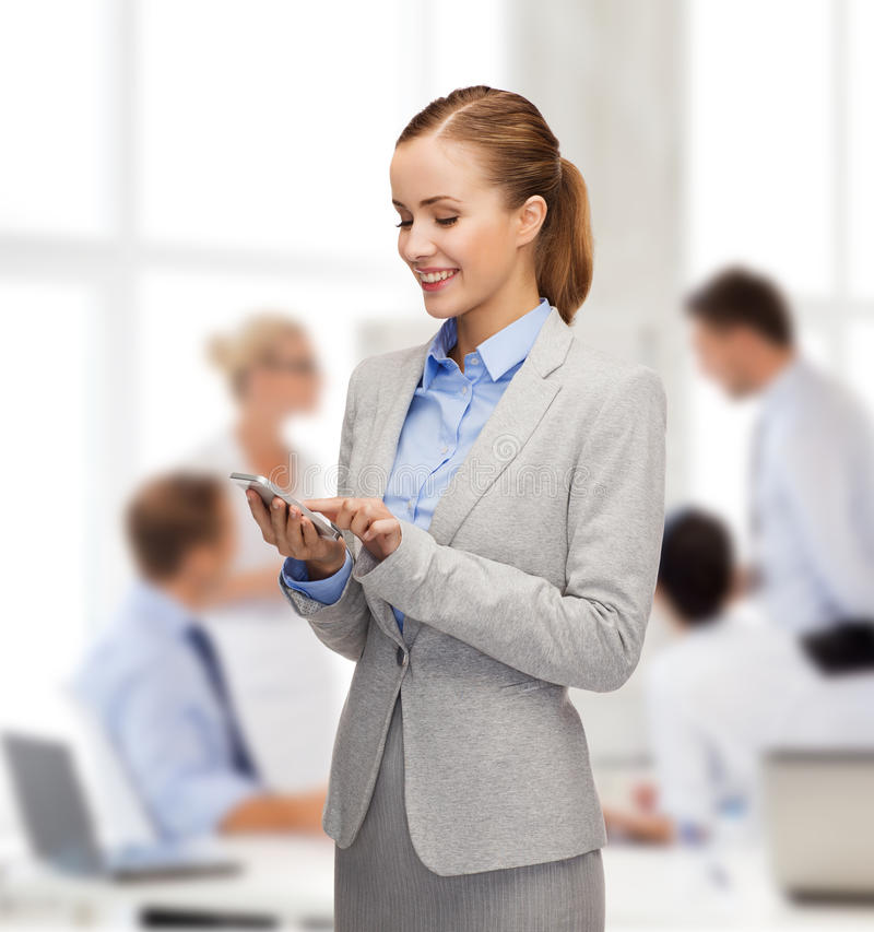 Download Young Smiling Businesswoman With Smartphone Stock Photo - Image: 40042364