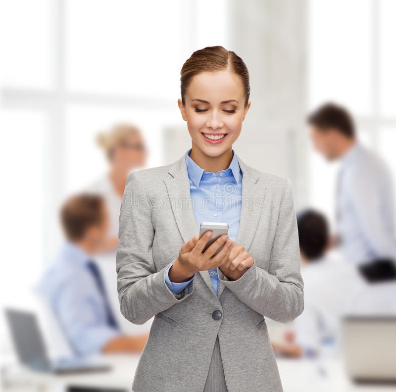 Download Young Smiling Businesswoman With Smartphone Stock Photo - Image: 40042450