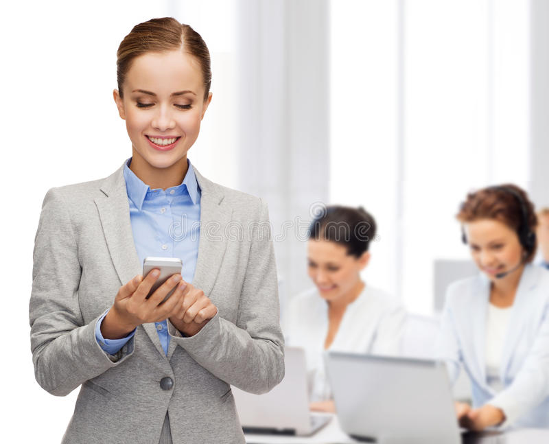 Download Young Smiling Businesswoman With Smartphone Stock Photo - Image: 40042719