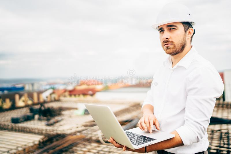 smiling and confident consultant, civil engineer supervising construction works royalty free stock photography