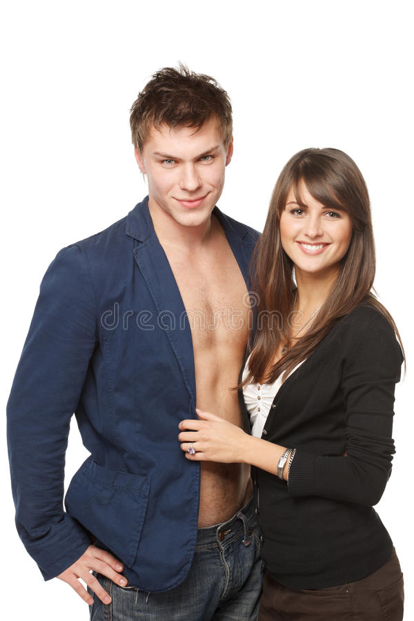 Young smiling couple. Portrait of a beautiful young happy smiling couple over white background stock photos