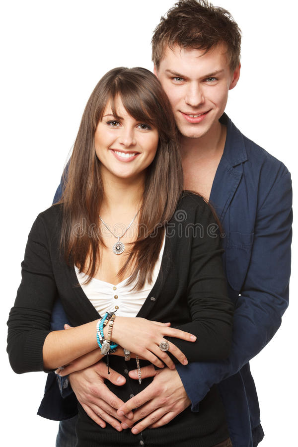 Young smiling couple. Portrait of a beautiful young happy smiling couple - isolated on white background royalty free stock photography