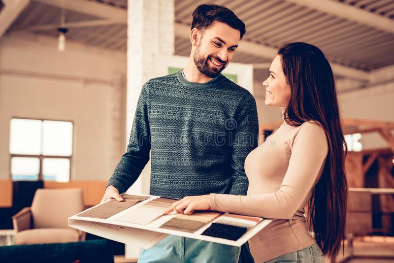 Young Couple Choose Furniture Color In Store royalty free stock photo