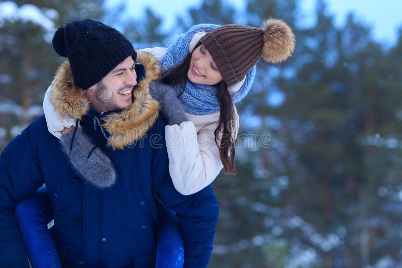 Young smiling couple walking outdoors together royalty free stock photography