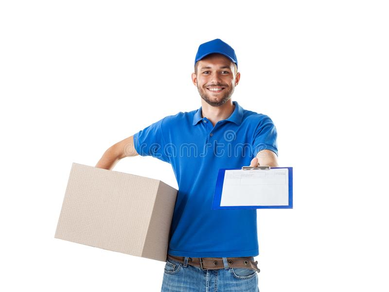 Young smiling courier delivering parcel boxes and stretch blank. To the customer, isolated on white background. Delivery service concept stock photo