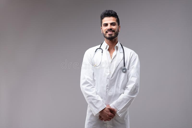 Young smiling doctor wearing white gown royalty free stock photos