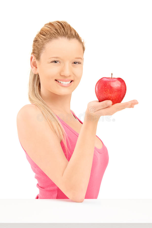 Download Young Smiling Female Holding A Red Apple Stock Photo - Image: 30993614