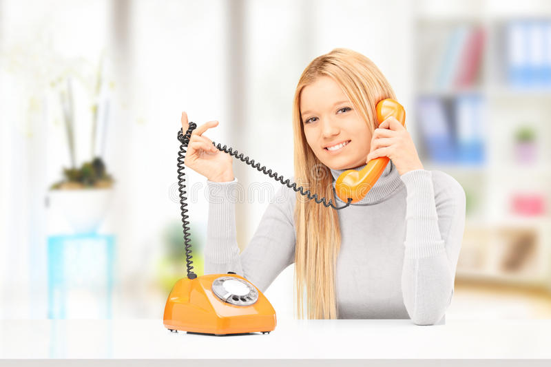 Download Young Smiling Female Talking On A Phone At Home Stock Photo - Image: 31065644