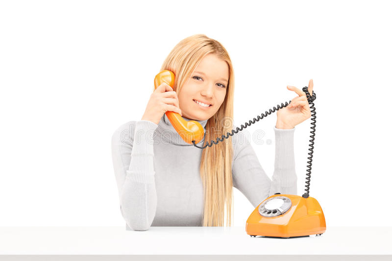Download Young Smiling Female Talking On A Retro Phone Stock Image - Image: 31065627