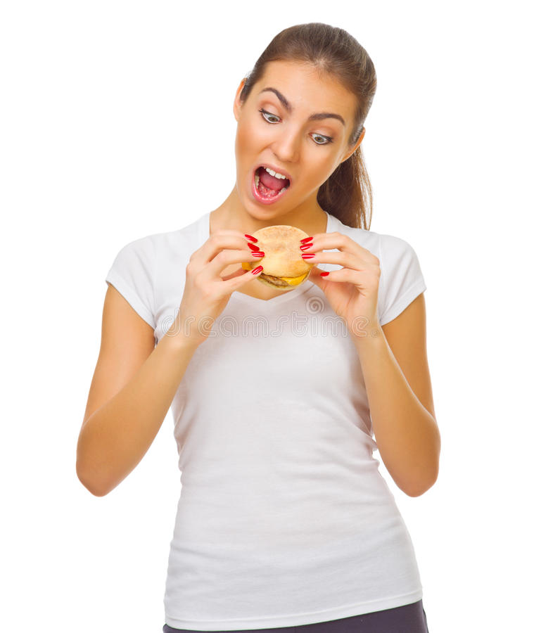 Young smiling girl eat hamburger. Isolated royalty free stock photography