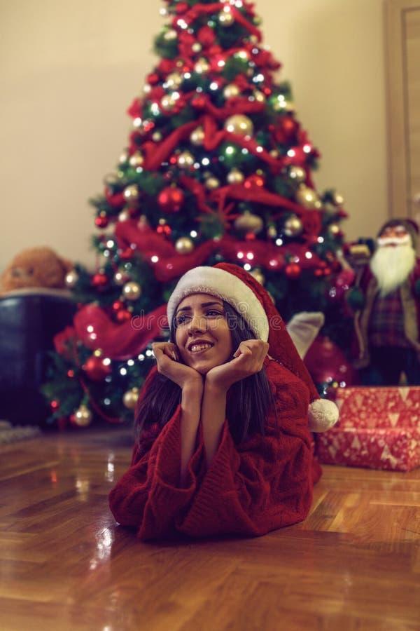 Smiling girl enjoying at Christmas time stock photography