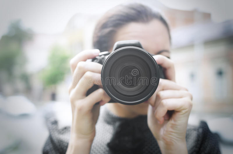 Young smiling girl making photo stock image