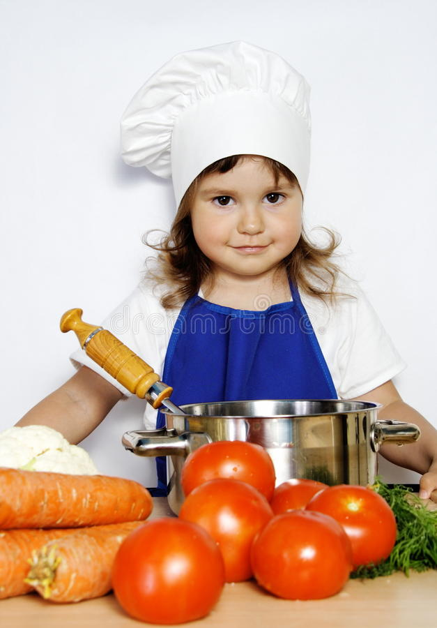 Young Smiling Girl Ready To Cook Stock Photos