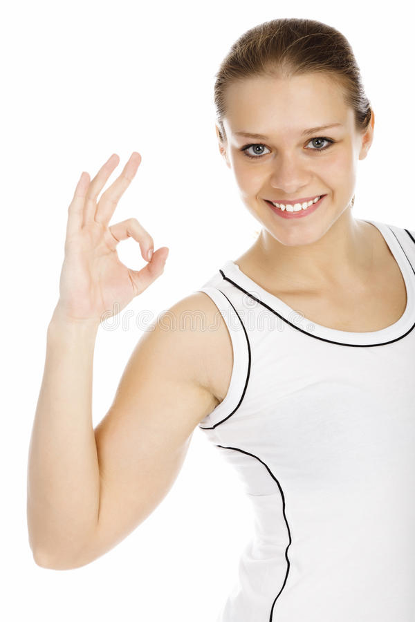 Young smiling girl showing OK sign