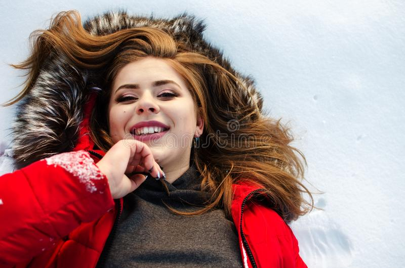 Young smiling girl in the winter royalty free stock photos