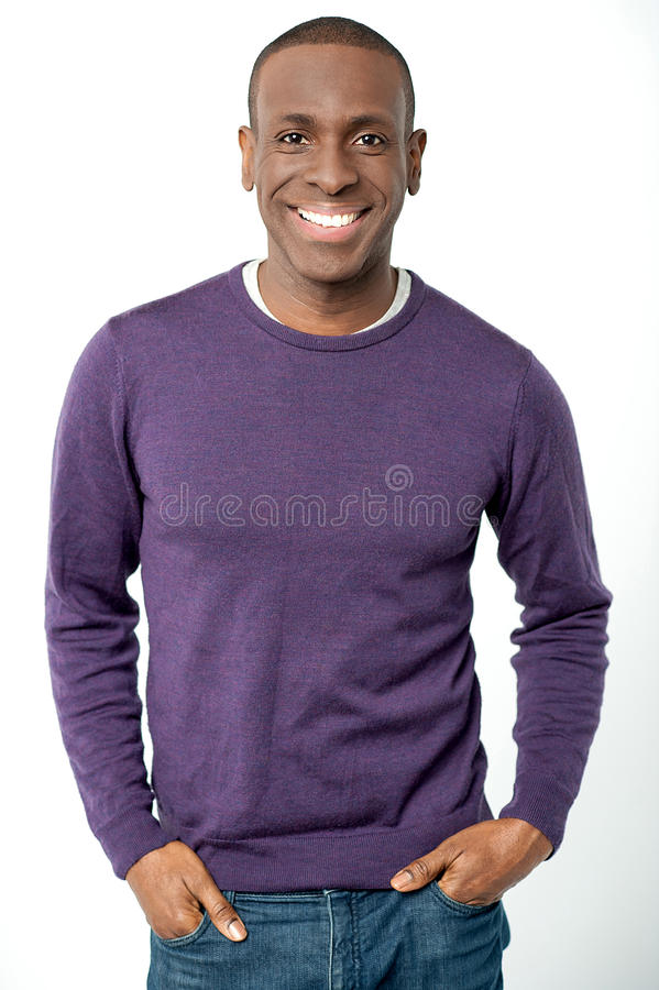 Young smiling guy in casual attire royalty free stock photos
