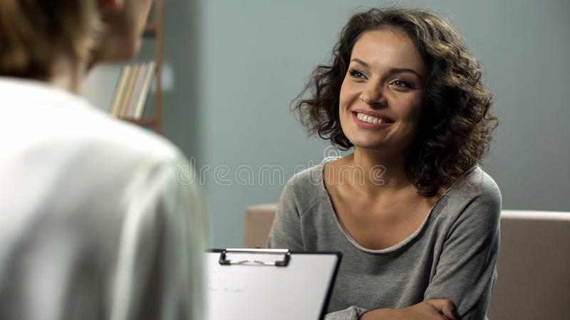 Young smiling lady at rehab therapy session, help from psychologist, improvement. Stock photo royalty free stock image