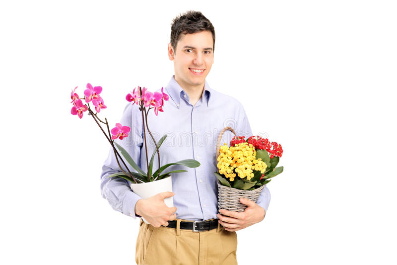Download A Young Smiling Male Holding Flowers Stock Photo - Image: 25469190