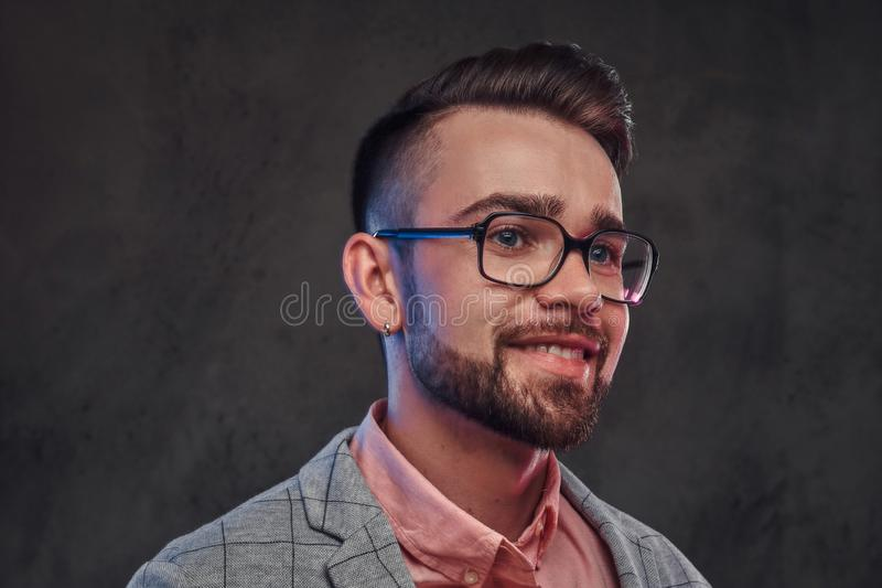 Young smiling man in checkered blazer, pink shirt and glasses. Portrait of young smiling man in checkered blazer, pink shirt and glasses royalty free stock photography