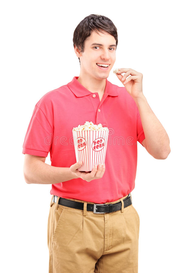 Download Young Smiling Man Eating Popcorn Stock Photo - Image: 28103304