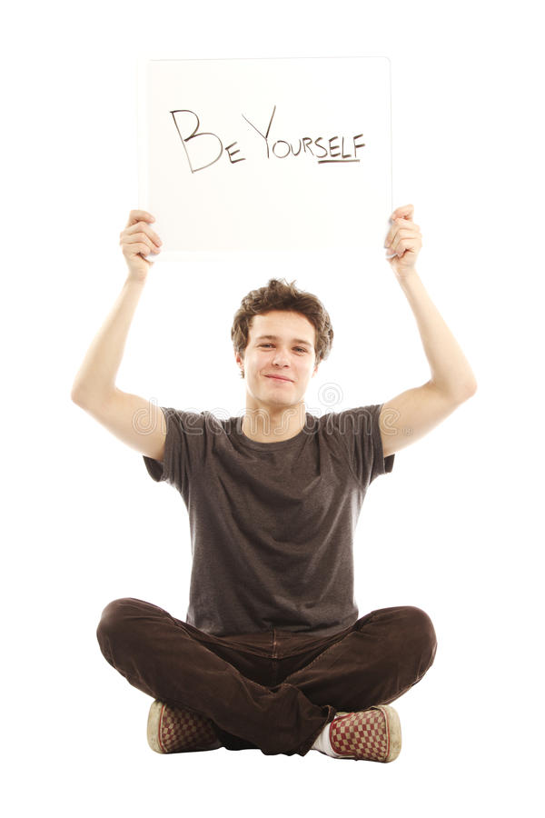 Free Young Smiling Man Holding Sign Up Royalty Free Stock Photography - 24629437