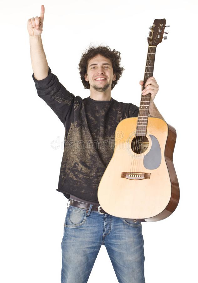 Man keeping guitar and pointing finger up stock photos