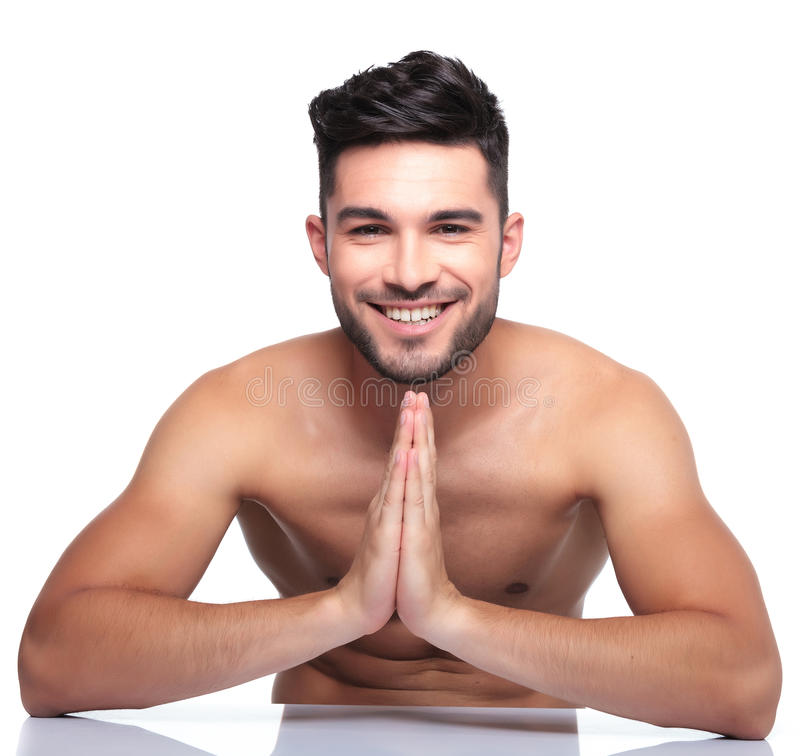 Young smiling man is praying royalty free stock photos