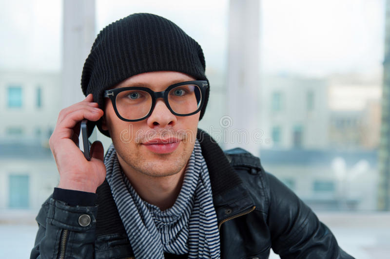 Young smiling man talking on the phone royalty free stock image