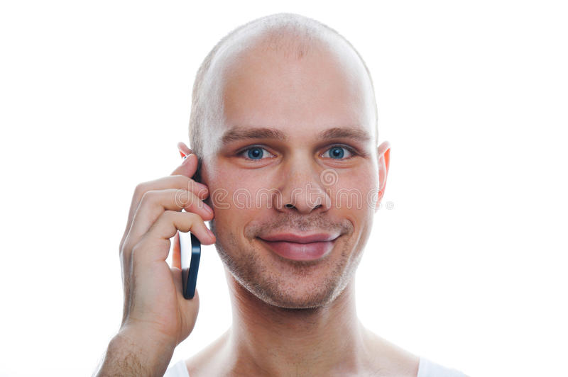 Young smiling man talking on the phone. On white background stock image