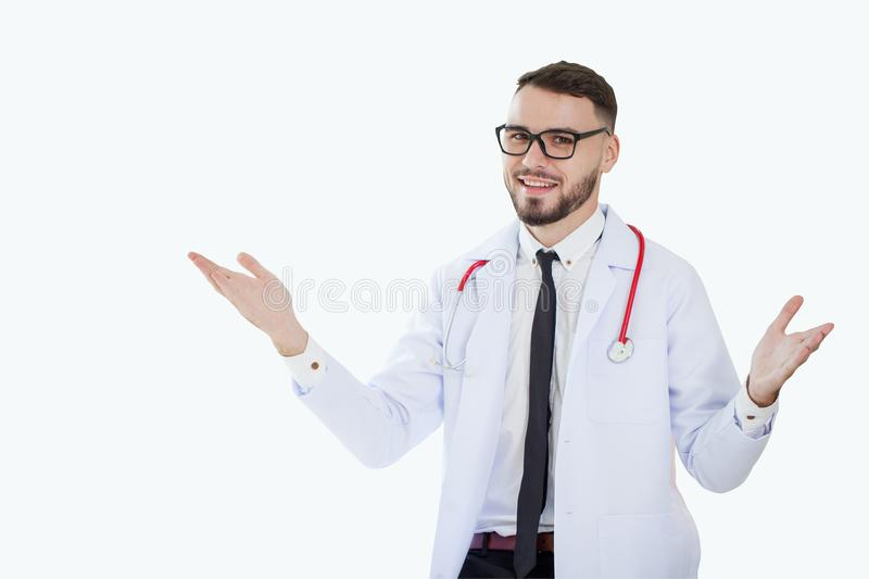 Young smiling medical doctor physician with stethoscope stretching out arms making a welcome gesture and smiling presenting royalty free stock photo