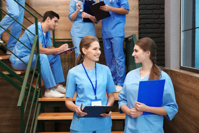 Young smiling medical students. In university hall royalty free stock photo