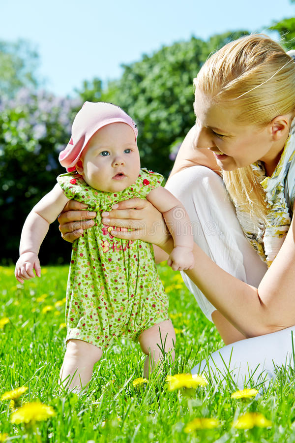 Young mother with baby-girl in park royalty free stock image