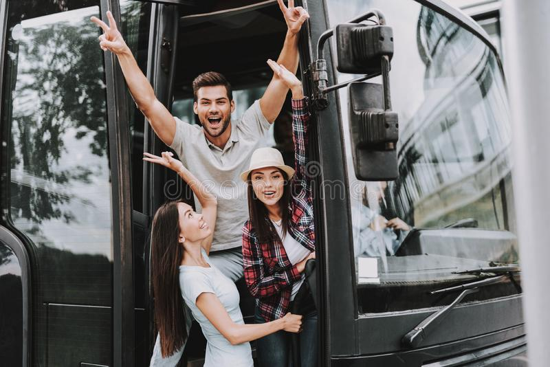 Young Smiling People Traveling on Tourist Bus royalty free stock photography